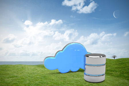 Hard drive symbol with cloud against green field under blue sky