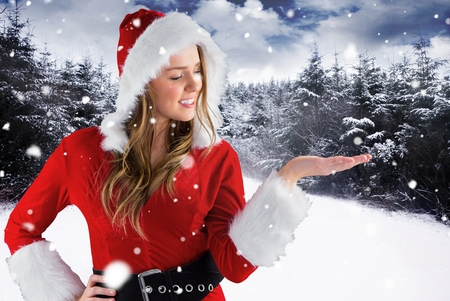 smoking woman: Digital Composite of Christmas Woman in front of Snowy Forest Design Stock Photo
