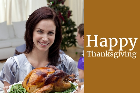 Digital Composite of Woman with Turkey and Thanksgiving Message Design photo