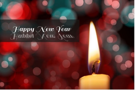 champagne flute: Digital Composite of New Year Message and Candle on Blurry Background Design Stock Photo