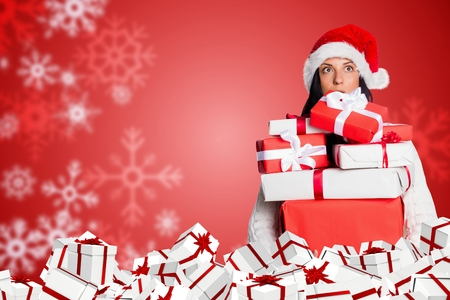 Digital composite of Woman hold Gift on Red and White Christmas Design Stock Photo