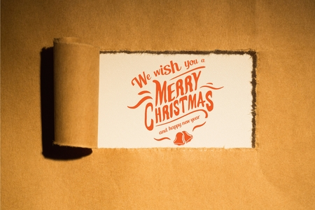 tearing down: Digital Composite of Christmas Message on Paper background Design Stock Photo
