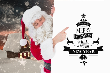 Digital Composite of Santa pointing Christmas Message Design