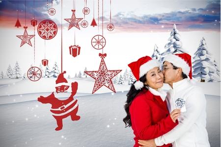 pere noel sexy: Couple in santa hat baiser sur le fond généré numériquement pendant le temps de Noël Banque d'images