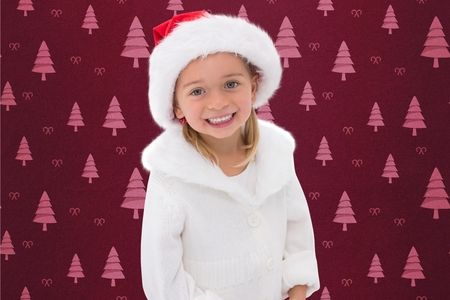 red cardigan: Portrait of girl in santa hat standing against digitally generated background during christmas time Stock Photo