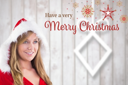 christmas costume: Woman in santa costume with christmas greeting during christmas time