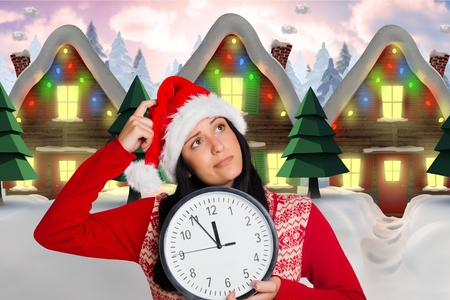 christmas time: Thoughtful woman in santa hat holding clock during christmas time