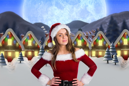pere noel sexy: Woman in santa costume standing against digitally generated background during christmas time Banque d'images