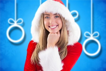 pere noel sexy: Beautiful woman in santa costume with hand on chin against digitally generated background during christmas time