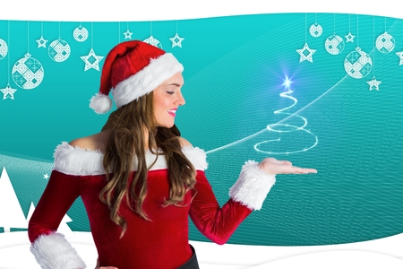 christmas time: Beautiful woman in santa costume gesturing agianst digitaly generated background during christmas time