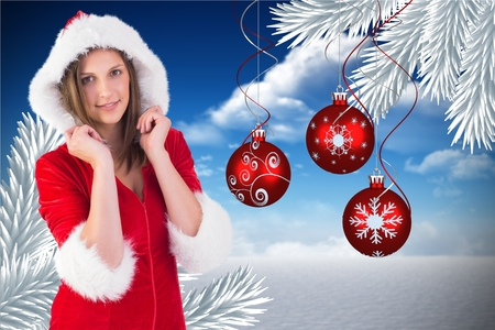 pere noel sexy: Portrait of beautiful woman in santa costume against digitally generated background during christmas time