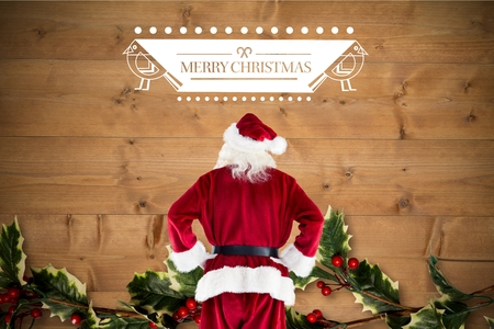 christmas time: Santa claus standing with hands on hips against digitally generated background during christmas time