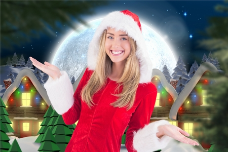 Portrait of beautiful woman in santa costume smiling at camera during christmas time
