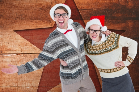 christmas time: Cutout image of happy couple in santa hat against digitally generated background during christmas time
