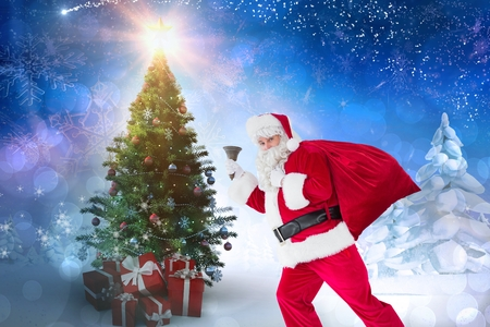 Portrait of woman in santa costume holding gifts against christmas background Stock Photo