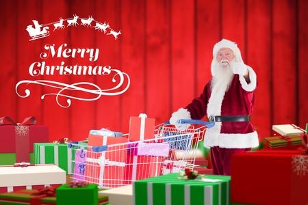 pere noel sexy: Santa claus montrant pouces vers le haut tout en tenant panier plein de cadeaux pendant le temps de Noël