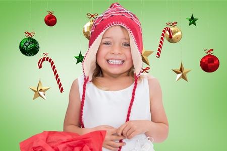 pere noel sexy: Portrait de jeune fille en tricot bonnet de laine sourire contre généré numériquement décoration de Noël pendant le temps de Noël Banque d'images