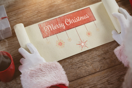 santa suit: Close-up of santa claus opening scroll against print