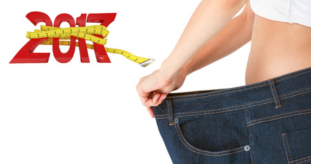 Woman belly in too big pants against new year with tape measure