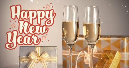 newyears: Print against gift boxes with champagne flutes Stock Photo