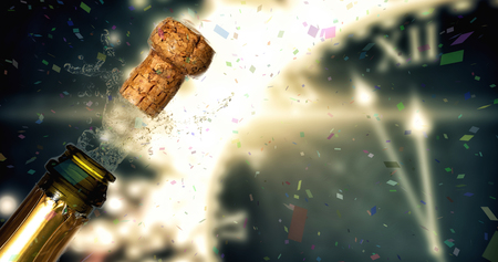 popping the cork: Flying colours against close up of champagne cork popping