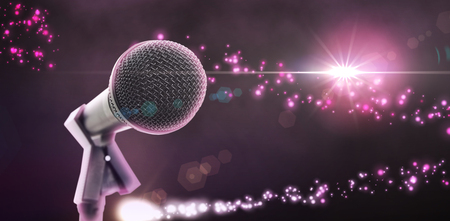 laser focus: Microphone with stand against bright light energy design in black and pink