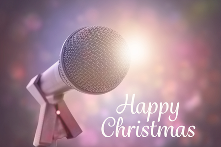 Happy christmas against purple abstract light spot design