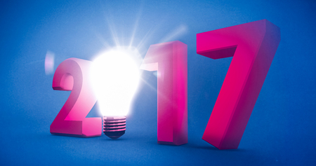 2017 with glowing light bulb over white background against blue background