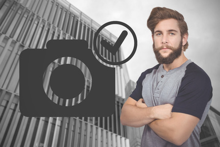 male wood tick: Portrait of confident hipster against low angle view of office building Stock Photo
