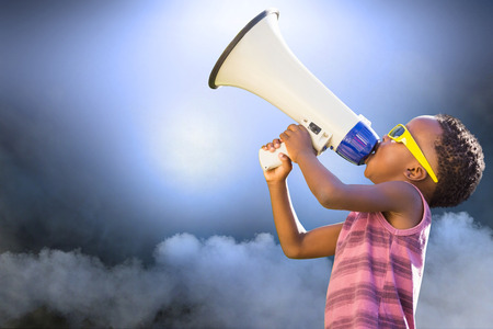 against abstract: Child with megaphone against abstract cloudy sky with lights Stock Photo