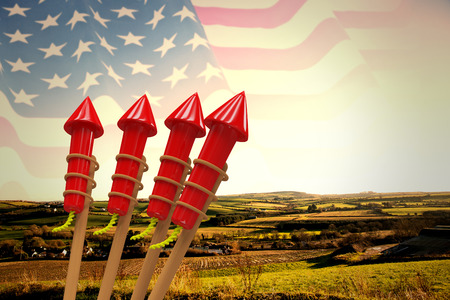 artifice: Rockets for fireworks against composite image of waving american flag