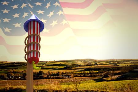 Rocket for fireworks against composite image of waving american flag