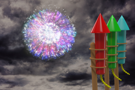 gloomy: Rockets for fireworks against colourful fireworks exploding on black background Stock Photo