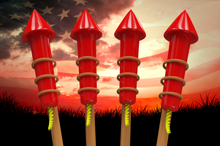 Rockets for fireworks against composite image of digitally generated american flag rippling