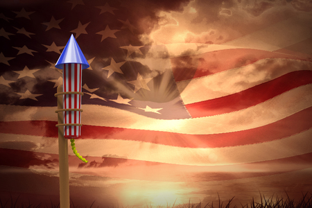 Rocket for fireworks against composite image of digitally generated american flag rippling