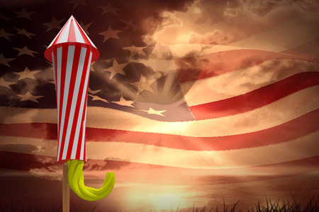 Rocket for firework against composite image of digitally generated american flag rippling Stock Photo