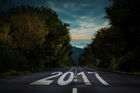 newyears: Happy New Year 2017 against open road background Stock Photo