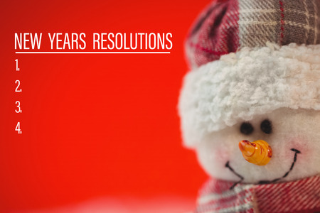 new years resolution: Composite image of new years resolution list and snowman against red Stock Photo
