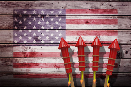 artifice: Rockets for fireworks against composite image of usa national flag Stock Photo