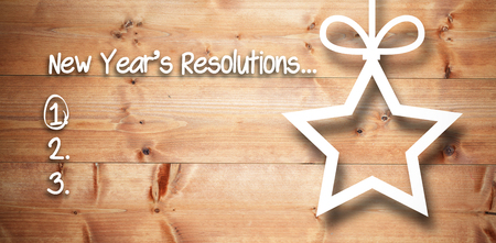 new years resolution: New years resolution list against christmas decorations over wood
