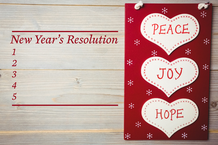 new years resolution: Composite image of new years resolution and text on wooden wall Stock Photo