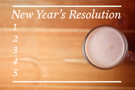 new years resolution: New Years Resolution List against hot chocolate cup Stock Photo