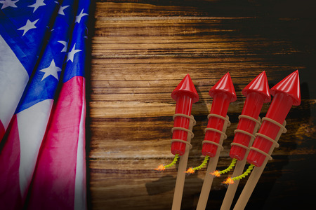 artifice: Rockets for fireworks against usa flag on table Stock Photo