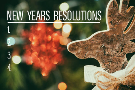 new years resolution: Composite image of new years resolution list and wood ornament
