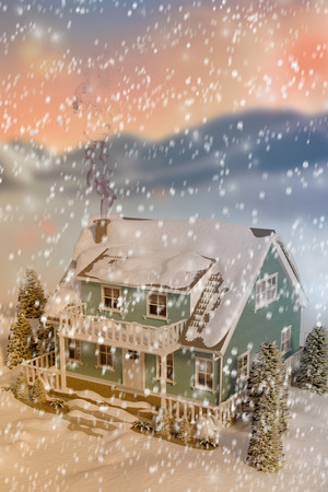 snow scape: High angle view of house covered in snow against digitally generated snowy land scape