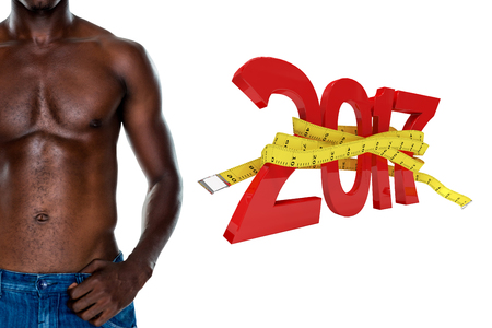 shirtless: Close-up mid section of a shirtless muscular man against digitally generated image of new year with tape measure Stock Photo