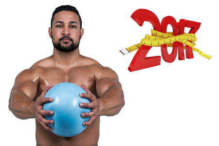 Muscular man working out with weight against digitally generated image of new year with tape measure