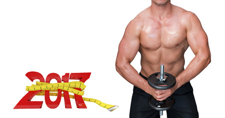 lean out: Bodybuilder lifting dumbbell against digital image of new year with tape measure