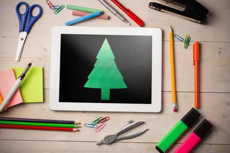 digitally generated image: Digitally generated image of Christmas tree against black