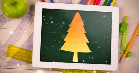 digitally generated image: Digitally generated image of orange Christmas tree against green chalkboard Stock Photo